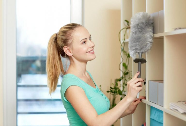 woman cleaning cabinet